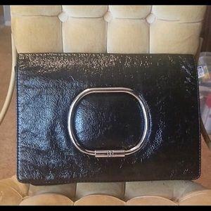 Nice BCBGmaxazria black leather clutch.